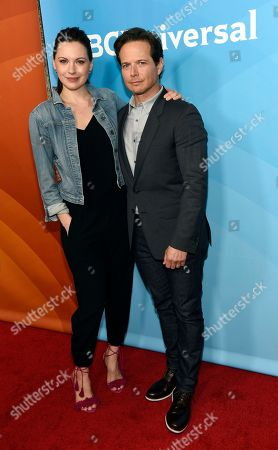 """Jill Flint, left, and Scott Wolf, cast members in the NBC series """"The Night Shift,"""" poses at the 2017 NBCUniversal Summer Press Day at the Beverly Hilton, in Beverly Hills, Calif"""