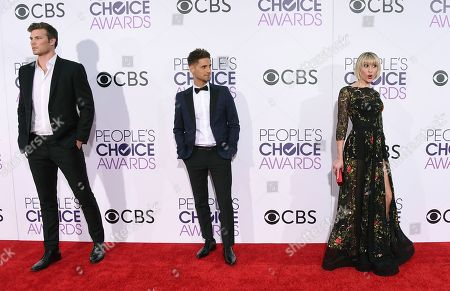 Derek Theler, from left, Jean-Luc Bilodeau, and Chelsea Kane arrive at the People's Choice Awards at the Microsoft Theater, in Los Angeles