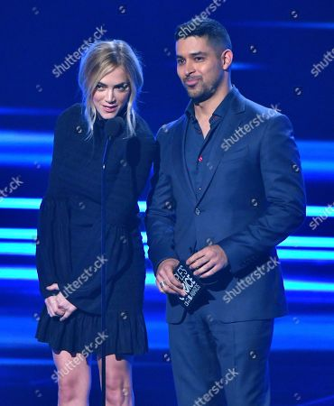 Emily Wickersham, left, and Wilmer Valderrama present the award for favorite network TV comedy at the People's Choice Awards at the Microsoft Theater, in Los Angeles