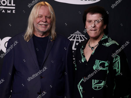 Rick Wakeman, left, and Trevor Rabin, right, of the band Yes pose in the 2017 Rock and Roll Hall of Fame induction ceremony press room at the Barclays Center, in New York