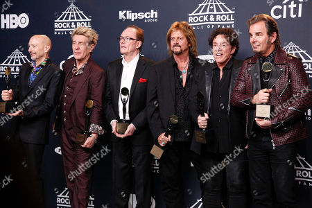 Steve Smith, from left, Ross Valory, Aynsley Dunbar, Gregg Rolie, Neal Schon and Jonathan Cain of the band Journey pose in the 2017 Rock and Roll Hall of Fame induction ceremony press room at the Barclays Center, in New York