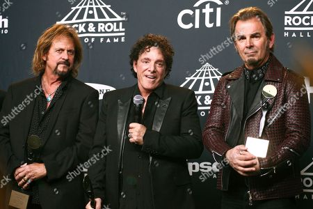 Gregg Rolie, from left, Neal Schon and Jonathan Cain of the band Journey pose in the press room at the 2017 Rock and Roll Hall of Fame induction ceremony at the Barclays Center, in New York
