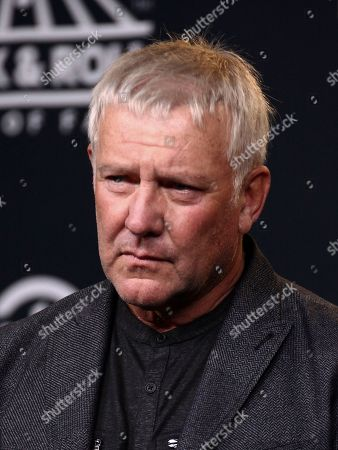 Alex Lifeson of the band Rush poses in the 2017 Rock and Roll Hall of Fame induction ceremony press room at the Barclays Center, in New York