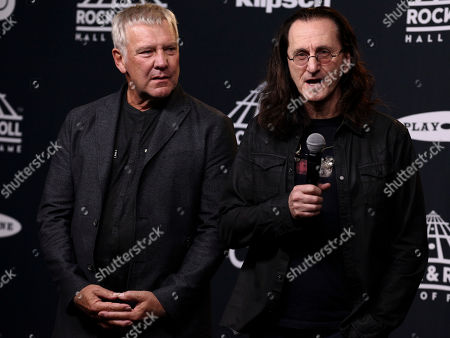 Alex Lifeson, left, and Geddy Lee, right, of the band Rush pose in the 2017 Rock and Roll Hall of Fame induction ceremony press room at the Barclays Center, in New York