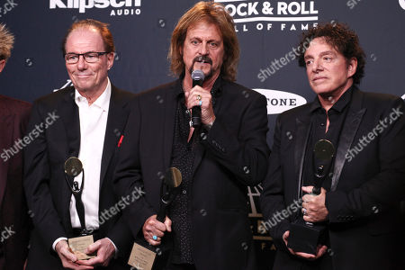 Aynsley Dunbar, from left, Gregg Rolie and Neal Schon of the band Journey pose in the 2017 Rock and Roll Hall of Fame induction ceremony press room at the Barclays Center, in New York
