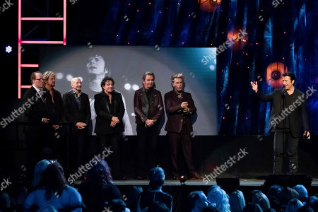 Inductee Steve Perry, right, from the band Journey speaks at the 2017 Rock and Roll Hall of Fame induction ceremony at the Barclays Center, in New York