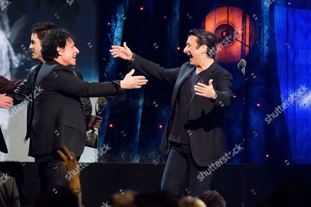Inductees Neal Schon, left, and Steve Perry from the band Journey appear at the 2017 Rock and Roll Hall of Fame induction ceremony at the Barclays Center, in New York