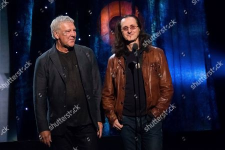 Alex Lifeson, left, and Geddy Lee from the band Rush appear at the 2017 Rock and Roll Hall of Fame induction ceremony at the Barclays Center, in New York