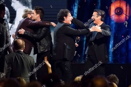 Inductees Steve Perry, from right, and Neal Schon from the band Journey appear at the 2017 Rock and Roll Hall of Fame induction ceremony at the Barclays Center, in New York