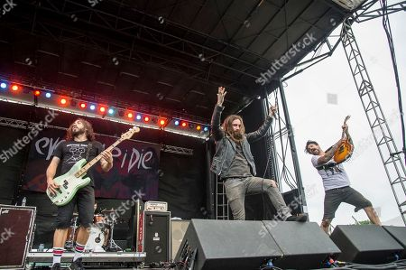 Stephen Micciche, from left, Keith Buckley, and Jordan Buckley of Every Time I Die performs at Rock On The Range Music Festival, in Columbus, Ohio