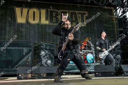 Rob Caggiano, left, and Michael Poulsen of Volbeat perform at Rock On The Range Music Festival, in Columbus, Ohio