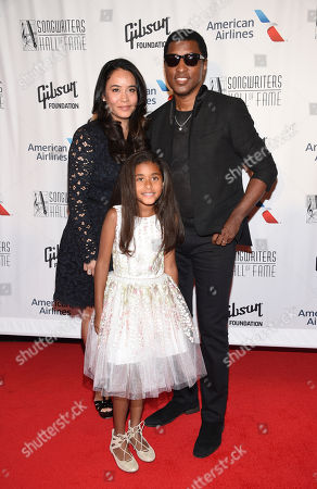 """Kenneth """"Babyface"""" Edmonds, right, Nicole Pantenburg, left, and Peyton Nicole Edmonds, center, attend the the 48th Annual Songwriters Hall of Fame Induction and Awards Gala at the New York Marriott Marquis Hotel, in New York"""