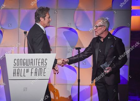Inductees Robert Lamm, left, and James Pankow accept their awards at the 48th Annual Songwriters Hall of Fame Induction and Awards Gala at the New York Marriott Marquis Hotel, in New York