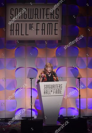 Stock Photo of President and CEO of the Songwriters Hall of Fame Linda Moran gives introductory remarks at the 48th Annual Songwriters Hall of Fame Induction and Awards Gala at the New York Marriott Marquis Hotel, in New York