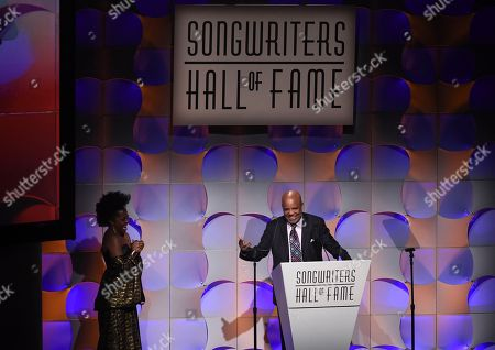 Music mogul Berry Gordy accepts his award, while his daughter Rhonda Ross Kendrick looks, at the 48th Annual Songwriters Hall of Fame Induction and Awards Gala at the New York Marriott Marquis Hotel, in New York