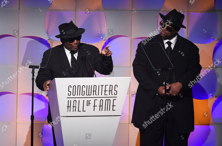 Songwriters Terry Lewis, left, and Jimmy Jam accept their awards at the 48th Annual Songwriters Hall of Fame Induction and Awards Gala at the New York Marriott Marquis Hotel, in New York