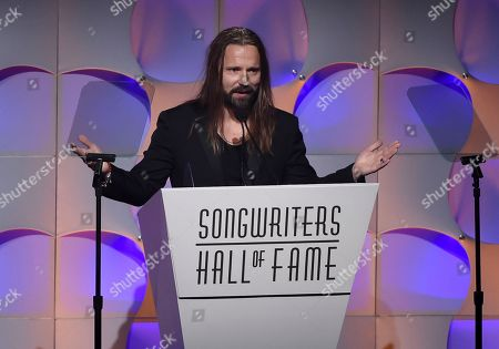 Songwriter Max Martin accepts his award at the 48th Annual Songwriters Hall of Fame Induction and Awards Gala at the New York Marriott Marquis Hotel, in New York
