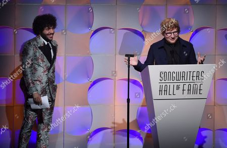 Singer-songwriter Ed Sheeran, right, thanks his presenter, Benny Blanco, during his acceptance speech for the Hal David Starlight Award at the 48th Annual Songwriters Hall of Fame Induction and Awards Gala at the New York Marriott Marquis Hotel, in New York