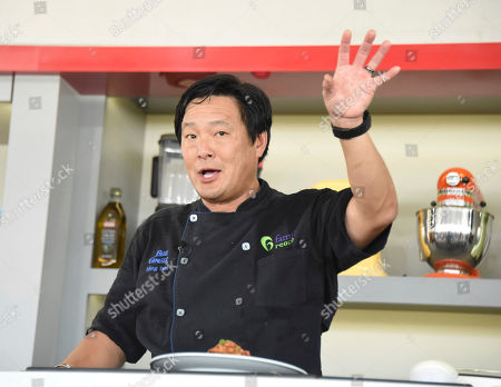 Stock Picture of Ming Tsai hosts the South Beach Wine & Food Festival - Goya Foods' Grand Tasting Village KitchenAid Culinary Demonstration on 13th Street & Ocean Drive, in Miami Beach, Fla