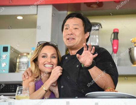 Giada De Laurentiis, left, and Ming Tsai host the South Beach Wine & Food Festival - Goya Foods' Grand Tasting Village KitchenAid Culinary Demonstration on 13th Street & Ocean Drive, in Miami Beach, Fla
