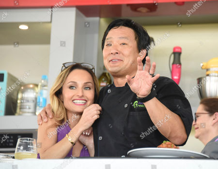 Stock Image of Giada De Laurentiis, left, and Ming Tsai host the South Beach Wine & Food Festival - Goya Foods' Grand Tasting Village KitchenAid Culinary Demonstration on 13th Street & Ocean Drive, in Miami Beach, Fla