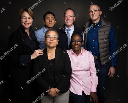 "Ophelia Dahl, from top left, Melquiades Huauya Ore, Dr. Paul Farmer, Eric Sawyer, Loune Viaud, bottom left, and Adeline Mercon, bottom right pose for a portrait to promote the film, ""Bending the Arc"", at the Music Lodge during the Sundance Film Festival, in Park City, Utah"