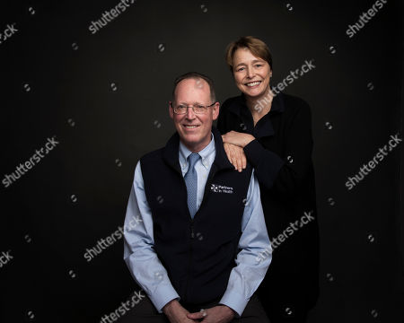 """Dr. Paul Farmer, left, and Ophelia Dahl pose for a portrait to promote the film, """"Bending the Arc"""", at the Music Lodge during the Sundance Film Festival, in Park City, Utah"""