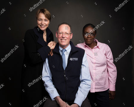 """Ophelia Dahl, from left, Dr. Paul Farmer and Adeline Mercon pose for a portrait to promote the film, """"Bending the Arc"""", at the Music Lodge during the Sundance Film Festival, in Park City, Utah"""