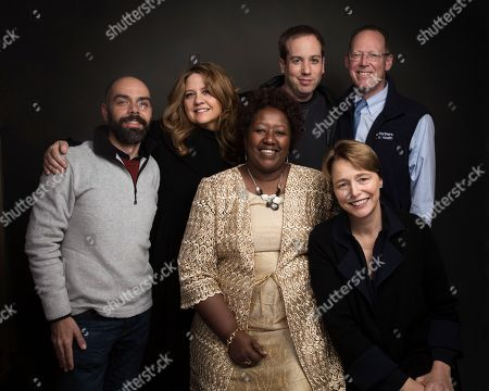 "Director Pedro Kos, from left, producer Cori Stern, Dr. Agnes Binagwaho, Director Kief Davidson, Dr. Paul Farmer and Ophelia Dahl pose for a portrait to promote the film, ""Bending the Arc"", at the Music Lodge during the Sundance Film Festival, in Park City, Utah"
