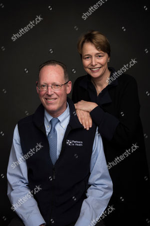 "Stock Photo of Dr. Paul Farmer, left, and Ophelia Dahl pose for a portrait to promote the film, ""Bending the Arc"", at the Music Lodge during the Sundance Film Festival, in Park City, Utah"