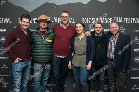 """From left, Michael Moran, Josh C. Waller, Daniel Noah, Lisa Whalen, Elijah Wood, and Fernando Szew pose at the premiere of the film """"Bitch"""" at the Library Center Theatre during the 2017 Sundance Film Festival, in Park City, Utah"""