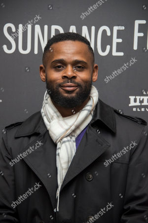 """Writer/director Gerard McMurray poses at the premiere of the film """"Burning Sands"""" at the Eccles Theatre during the 2017 Sundance Film Festival, in Park City, Utah"""