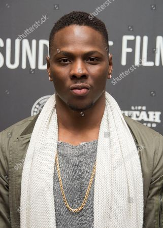 """Actor Mitchell Edwards poses at the premiere of the film """"Burning Sands"""" at the Eccles Theatre during the 2017 Sundance Film Festival, in Park City, Utah"""