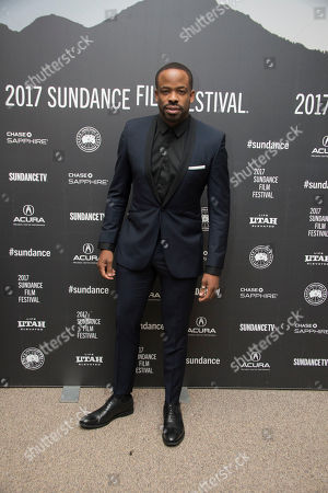 """Actor Chike Okonkwo poses at the premiere of the film """"Burning Sands"""" at the Eccles Theatre during the 2017 Sundance Film Festival, in Park City, Utah"""