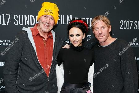"""Michael Eisner, left, and his son producer Eric Eisner, right, and Eric's wife clothing designer Stacey Bendet, center, pose at the premiere of """"Long Strange Trip,"""" a documentary about the Grateful Dead rock group, during the 2017 Sundance Film Festival, in Park City, Utah"""