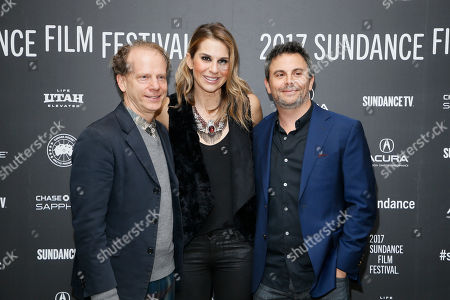 """Stock Photo of Producers Bruce Cohen, left, Molly Smith, center, and Jason Shuman, right, pose at the premiere of """"Rebel In The Rye"""" during the 2017 Sundance Film Festival, in Park City, Utah"""