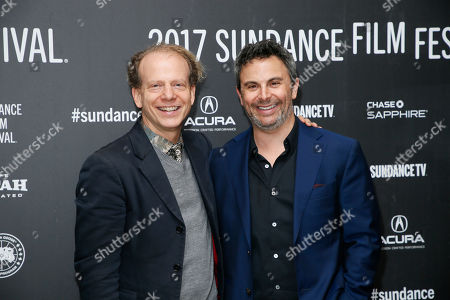 """Producers Bruce Cohen, left, and Jason Shuman, right, pose at the premiere of """"Rebel In The Rye"""" during the 2017 Sundance Film Festival, in Park City, Utah"""