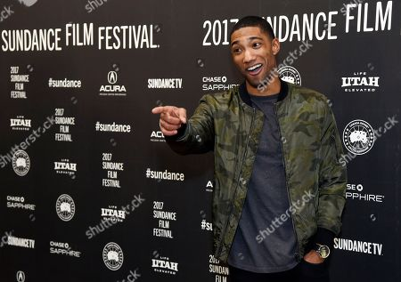 """Carter Redwood, a cast member in """"The Yellow Birds,"""" banters with photographers at the premiere of the film at Eccles Theatre during the 2017 Sundance Film Festival, in Park City, Utah"""