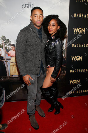 """Actor Kevin Phillips, left, and actress Danielle Mone Truitt pose at WGN America's """"Underground"""" Sundance red carpet celebration party during the 2017 Sundance Film Festival, in Park City, Utah"""