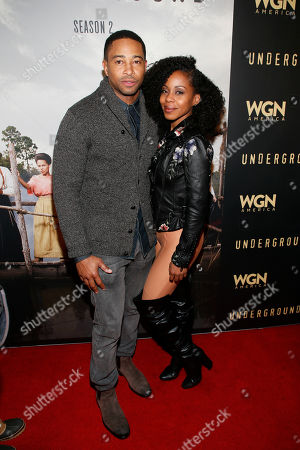 Actor Kevin Phillips, left, and actress Danielle Mone Truitt pose at WGN America's 'Underground' Sundance red carpet celebration party during the 2017 Sundance Film Festival, in Park City, Utah