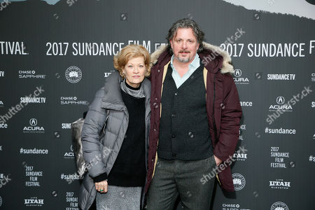 """Director Alex Smith, right, and wife actress Dana Wheeler-Nicholson, left, pose at the premiere of """"Walking Out"""" during the 2017 Sundance Film Festival, in Park City, Utah"""