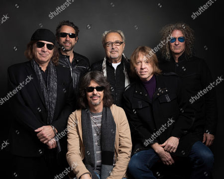 Thom Gimbel, from left, Michael Bluestein, Mick Jones, Kelly Hansen, Jeff Pilson and Bruce Watson of Foreigner pose for a portrait at the Music Lodge during the Sundance Film Festival, in Park City, Utah