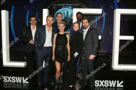 "Hiroyuki Sanada, from left, Ryan Reynolds, director Daniel Espinosa, Olga Dihovichnaya, Rebecca Ferguson, Ariyon Bakare and Jake Gyllenhaal, arrive for the world premiere of ""Life"" at the ZACH Theatre during the South by Southwest Film Festival, in Austin, Texas"