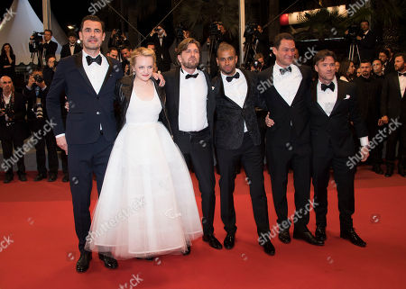 From left, actors Claes Bang and Dominic West, director Ruben Ostung and actors Christopher Laesso, Dominic West and Terry Notary pose for photographers upon arrival at the screening of the film The Square at the 70th international film festival, Cannes, southern France