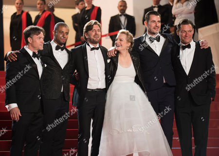 From left, actors Terry Notary and Christopher Laesso, director Ruben Ostung, and actors Elisabeth Moss, Claes Bang and Dominic West for photographers upon arrival at the screening of the film The Square at the 70th international film festival, Cannes, southern France