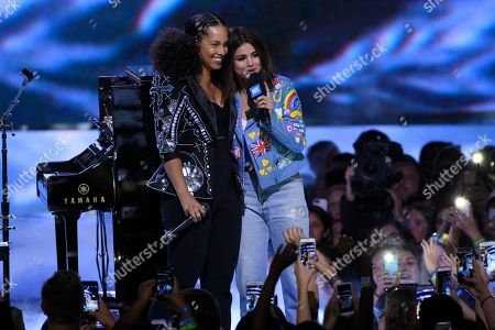 Alicia Keys, left, and Selena Gomez speak at WE Day California at the Forum, in Inglewood, Calif