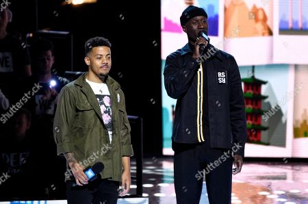 Stock Photo of Nico Sereba, left, and Vinzy V, of Nico & Vinz, speak at WE Day California at the Forum, in Inglewood, Calif