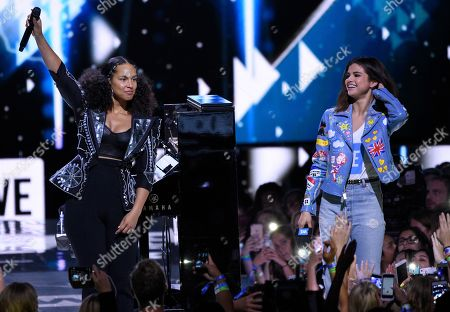 Alicia Keys, left, and Selena Gomez appear at WE Day California at the Forum, in Inglewood, Calif