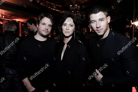 Byron Balasco, from left, Wendy Moniz and Nick Jonas attend the afterparty at the Direct TV portion of the 2017 Winter Television Critics Association press tour in, in Pasadena, Calif
