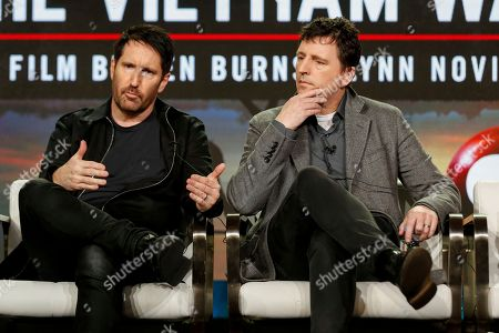 "Trent Reznor, left. and Atticus Ross speak at PBS' ""The Vietnam War"" panel at the 2017 Television Critics Association press tour, in Pasadena, Calif"